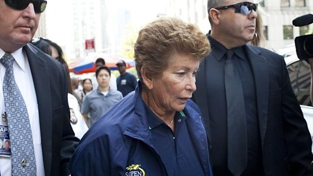 Lois Ann Goodman, 70, is led away from the Manhattan Criminal Court after being extradited to California (Reuters)