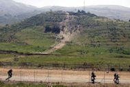 Israeli soliders patrol along the ceasefire line between the Israeli-occupied Golan Heights and Syria, on June 6, 2011. Israel forces have carried out an air strike overnight on a weapons convoy from Syria near the Lebanese border, security sources told AFP on condition of anonymity.