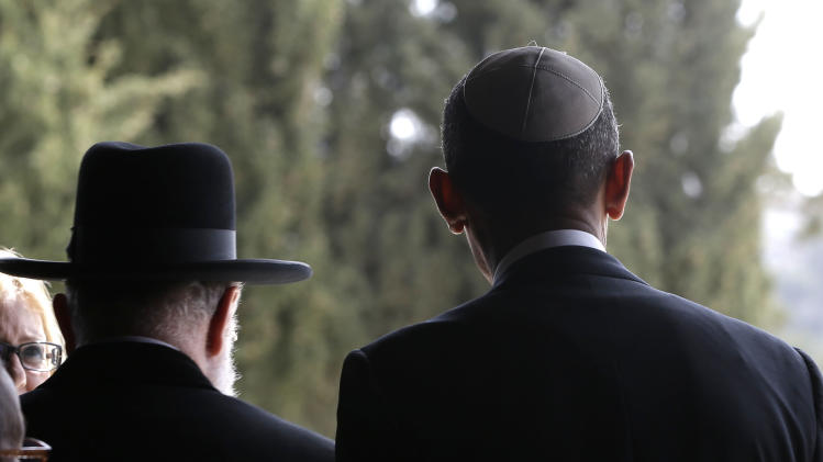 U.S. President Barack Obama, right, walks out with Rabbi Meir Lau, left, after visiting the Hall of Remembrance at the Vad Vashem Holocaust Memorial in Jerusalem, Israel, Friday, March 22, 2013. (AP Photo/Pablo Martinez Monsivais)