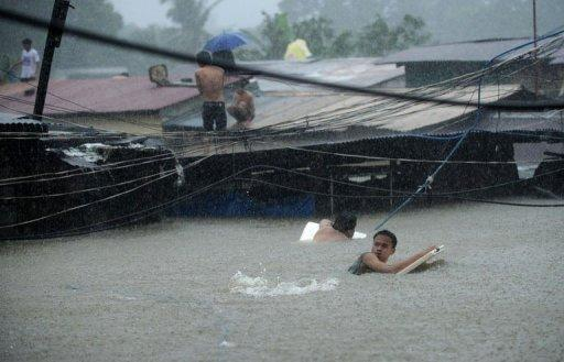 The worst flood-hit parts of Manila were the poorest districts, where millions of slum dwellers live along riverbanks