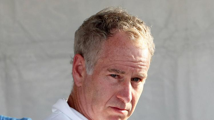 "FILE - This July 8, 2011 file photo shows tennis legend John McEnroe before a men's double exhibition match in Saint Tropez, southern France. McEnroe has an agreement with Little, Brown and Company for a book, currently untitled, that is scheduled for 2014. The publisher announced Monday, June 24, 2013, that McEnroe will focus on his years as a businessman and tennis broadcaster. McEnroe, 54, is the author of a previous memoir, the best-selling ""You Cannot Be Serious."" (AP Photo/Claude Paris, file)"