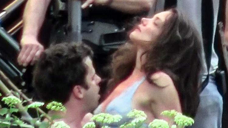 Katie Holmes and Luke Kirby filming a love scene in a tree on the Lower East Side in NYC