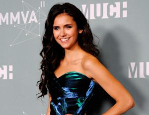 Sexy Nina Dobrev poses for the cameras.