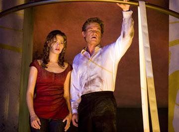 Emmy Rossum and Kurt Russell in Warner Bros. Pictures' Poseidon