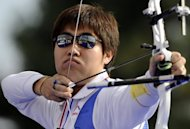 South Korean Im Dong-Hyun shoots during the individual recurve men's final he won 112 to 110 against Ukrainian Viktor Ruban at the archery World Cup final on September 27, 2008 in Lausanne. Im set the first world record of the London Olympics on Friday and then added another as South Korea broke the team record