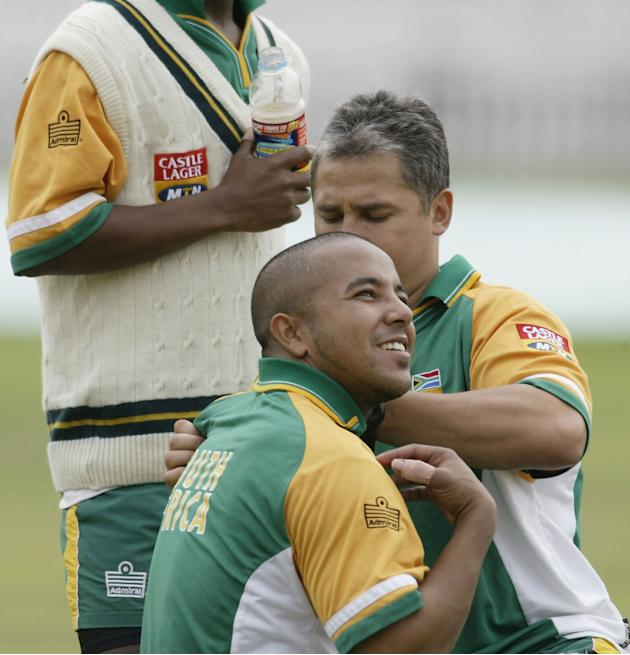 Paul Adams of South Africa gets treatment on his shoulder after he was hit by the ball in training