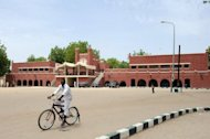 A cyclist rides past the palace of Shehu of Bornu, the traditional ruler of Bornu in Maiduguri, in northeastern Nigeria in May 2012. Maiduguri has been one of the targets of Boko Haram's deadly assaults, with scores of people killed in recent months