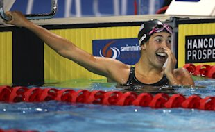 Maya Dirado smiles as she looks back to the scoreboard after a 200 IM event at the Pan Pacific games in 2014. (AP)