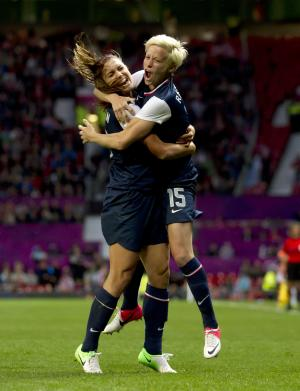 United States' Megan Rapinoe, right, celebrates with teammate Alex Morgan after scoring against Canada during their semIfinal women's soccer match at the 2012 London Summer Olympics, Monday, Aug. 6, 2012 at Old Trafford Stadium in Manchester, England. (AP Photo/Jon Super)