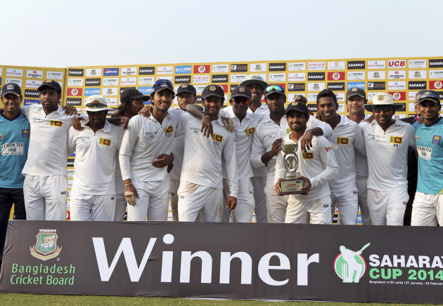 Sri Lankan cricketers pose for photographs during a presentation ceremony after the second test cricket match against Bangladesh in Chittagong, Bangladesh, Saturday, Feb. 8, 2014. Sri Lanka and Bangla
