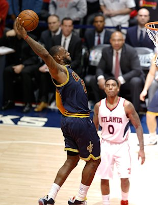 ATLANTA, GA - MAY 20: Forward LeBron James #23 of the Cleveland Cavaliers dunks to seal the game while guard Jeff Teague #0 of the Atlanta Hawks looks on during Game One of the Eastern Conference Finals during the NBA Playoffs at Philips Arena on May 20, 2015 in Atlanta, Georgia. NOTE TO USER: User expressly acknowledges and agrees that, by downloading and or using this photograph, User is consenting to the terms and conditions of the Getty Images License Agreement. (Photo by Mike Zarrilli/Getty Images)