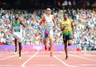 (From L) Saudi Arabia's Yousef Ahmed Masrahi, Venezuela's Albert Bravo and Jamaica's Jermaine Gonzales compete in the men's 400m heats at the athletics event of the London 2012 Olympic Games on August 4, 2012 in London. AFP PHOTO / OLIVIER MORIN