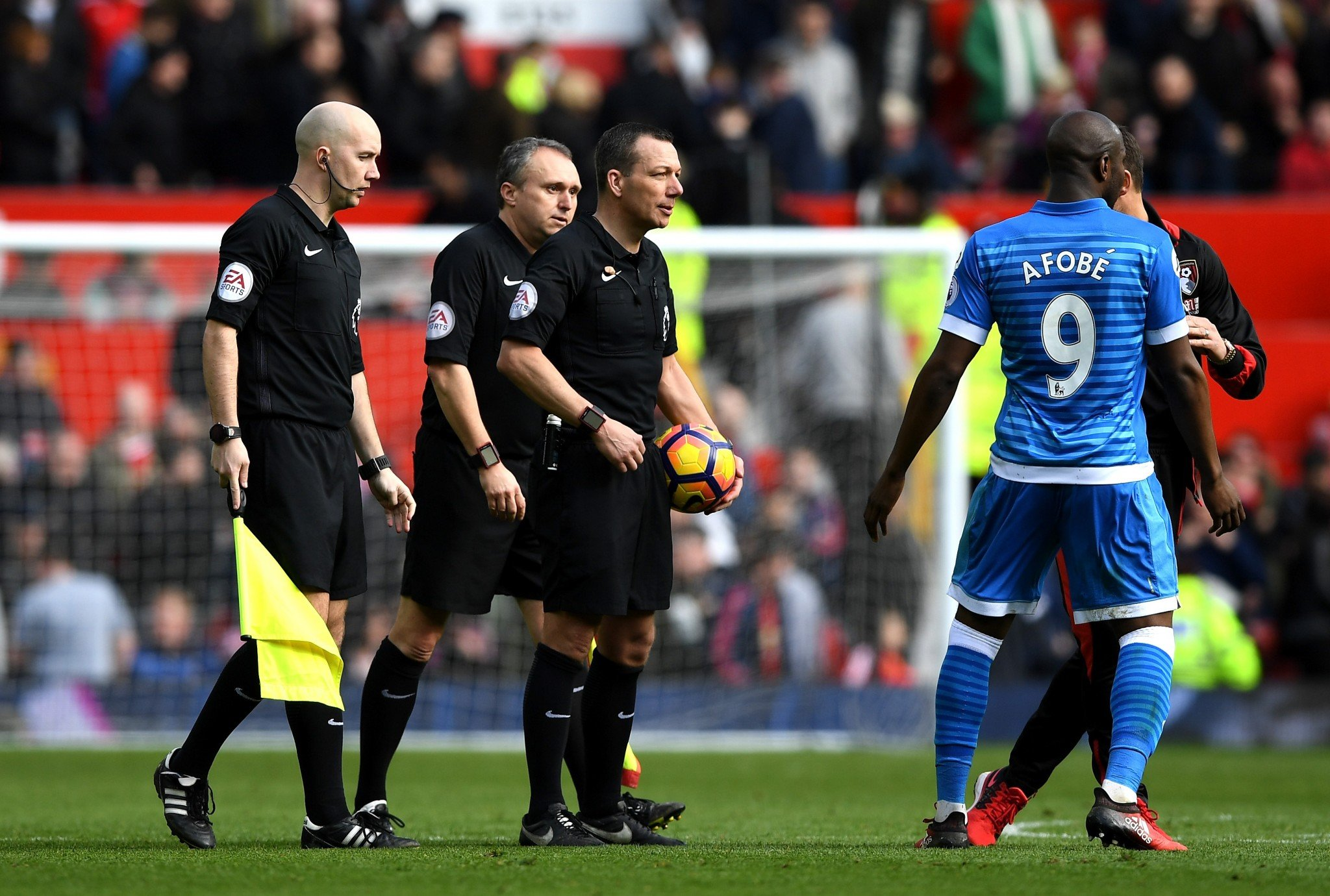 Benik Afobe challenges the officials after Andrew Surman's red card