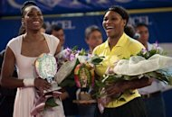 US tennis players Serena (R) and Venus Williams laugh after a 2011 exhibition match. After over a decade as the sport's most dominant forces, both Serena and Venus head into Wimbledon, which starts on Monday, without a grand slam title between them since 2010
