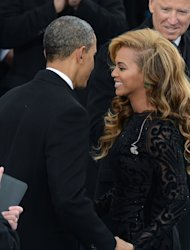 US President Barack Obama greets singer Beyoncé on January 21, 2013 in Washington, DC. Soul legend Aretha Franklin and younger singing stars Alicia Keys, Jennifer Lopez and LeAnn Rimes sprung to Beyonce's defense, with Franklin saying it made sense to go with a backing track given the near-freezing temperatures
