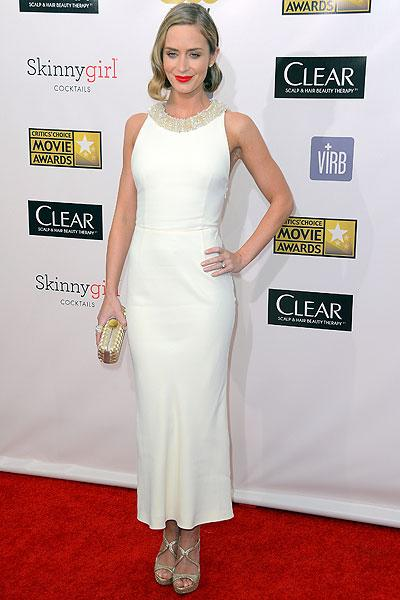 Emily Blunt:  We can always count on Emily to look gorgeous and she doesn't disappoint in this cream Miu Miu ensemble. The dress could have looked drab were it not for the crystal-studded neckline which livened it up. (Photo by Frazer Harrison/Getty Images)