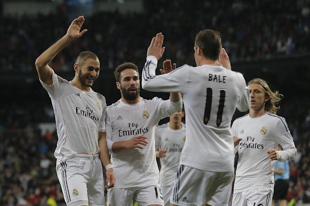Real Madrid's Karim Benzema from France, left, celebrates his goal with Real Madrid's Gareth Bale from Great Britain, second right, and teammates during a Spanish La Liga soccer match between