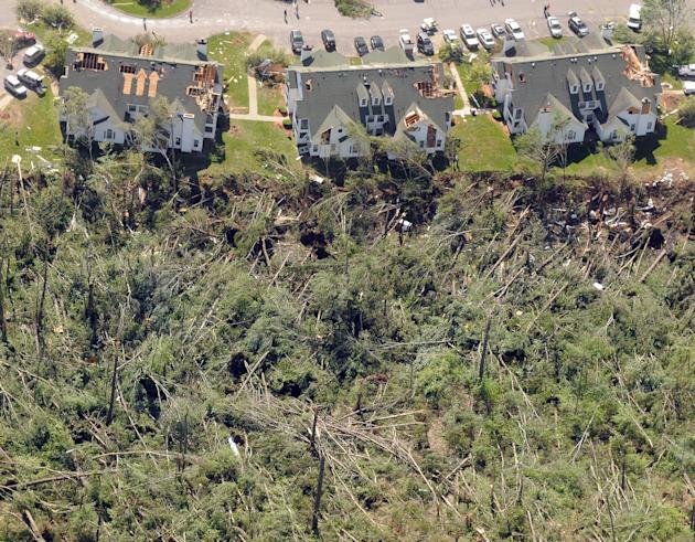 In this aerial photo, heavy damage to the Rosemeade Apartments complex and surrounding forest on Worcester Street in Southbridge is seen  in Brimfield, Mass. on Thursday, June 2, 2011 in the aftermath