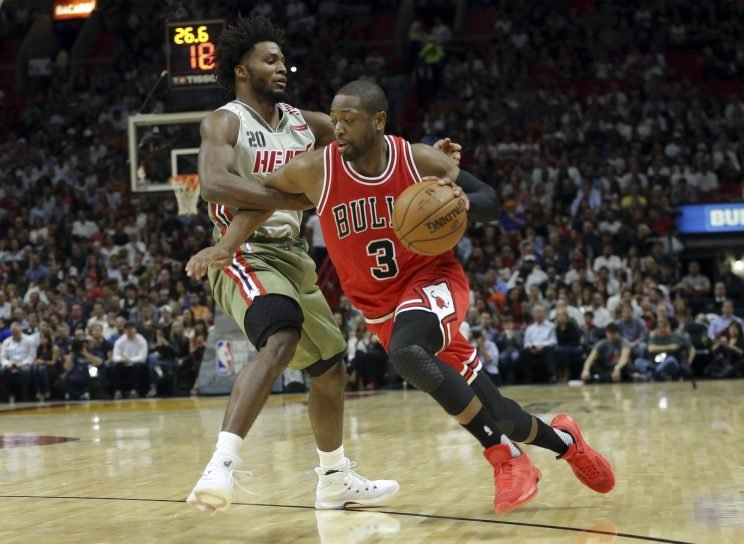 Dwyane Wade drives to the basket during his first game back in Miami. (Associated Press)
