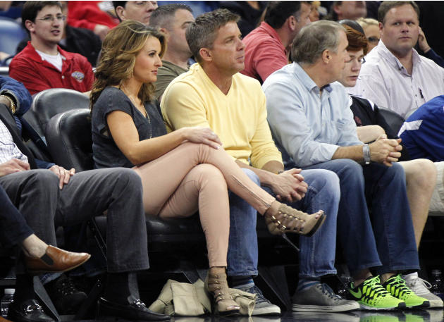 New Orleans Saints head coach Sean Payton sits with his girlfriend Skylene Montgomery in the first half of an NBA basketball game between the New Orleans Pelicans and the Houston Rockets in New Orlean