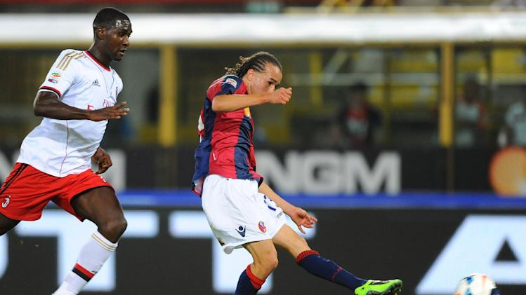 Bologna midfielder Diego Laxalt, right, of Uruguay, scores during the Serie A soccer match between Bologna and Milan, at Bologna's Renato Dall'Ara stadium, Italy, Wednesday, Sept. 25, 2013