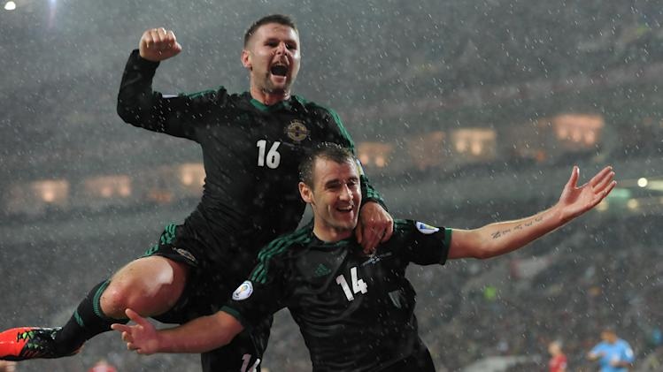 Oliver Norwood and Niall McGinn celebrate Northern Ireland's opener against Portugal