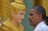 US President Barack Obama performs a ritual during a visit to the Shwedagon pagoda in Yangon. Miles of smiles lit up shabby Yangon Monday during a visit by Obama, a striking contrast to the wrenching, dark years under a xenophobic junta.