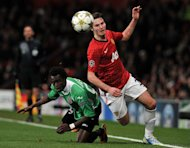 Manchester United midfielder Nick Powell (R) is brought down by Cluj's forward Modou Sougou. Cluj coach Paulo Sergio admitted his team were left with mixed feelings after coming away from United with a victory, only to exit the Champions League due to their head to head record against Galatasary