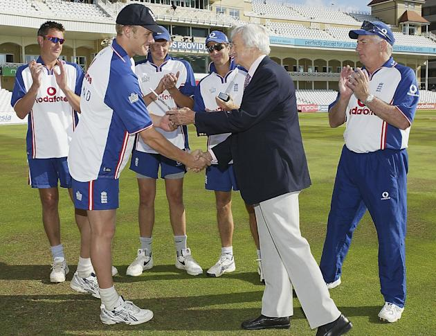 NOTTINGHAM, ENGLAND - AUGUST 14:  Andrew Flintoff of England (L) is presented with a trophy by Richie Benaud on making a century in the second test during the first day of the third npower test match