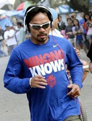 "Philippine boxing icon Manny Pacquiao jogs with his fans at the start of his training in Baguio City, north of Manila in April 2012. ""Somebody asked me what my opinion of legalizing same-sex marriage is,"" Pacquiao said. ""I said what I think. It is against the law of God."""