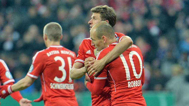 Munich's scorer Thomas Mueller, center, and Arjen Robben of the Netherlands, right, celebrate after scoring during the German soccer cup, DFB Pokal, semifinal match between FC Bayern Munich and FC Kaiserslautern in the Allianz Arena in Munich, Germany, on Wednesday, April 16. 2014