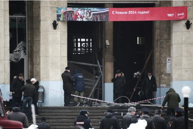 Investigators work at the site of an explosion at the entrance to a train station in Volgograd