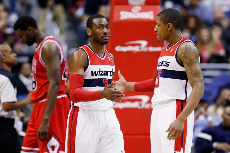 John Wall and Bradley Beal feel the love. (Rob Carr/Getty Images)