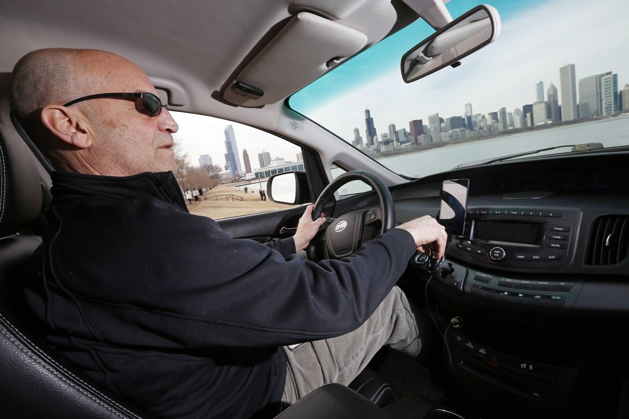 Uber driver Glen Snower sits in a BYD e6 electric car in Chicago, Illinois March 18, 2015. (REUTERS/Jim Young)