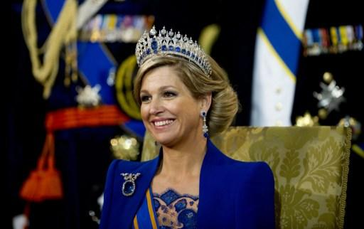 Queen Maxima smiles after the inauguration of her husband King Willem-Alexander of the Netherlands at the Nieuwe Kerk (New Church) in Amsterdam, on April 30, 2013.  AFP PHOTO / POOL / ROBIN UTRECHT