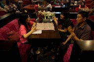 A couple is seen talking with a staff member at a singles club in Beijing. Pressure on China's women today is huge. Part of this is due to nation's one-child population control policy, which adds to the desperation of parents for their only offspring to marry and produce a grandson or granddaughter
