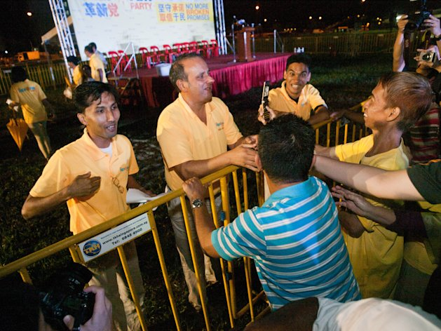 Kenneth Jeyaretnam shakes the hands of those who wish him luck in the four-corner by-election. (Yahoo! photo/Alvin Ho)