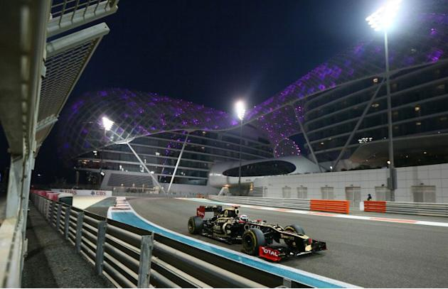 Lotus F1 Team's Finnish driver Kimi Raikkonen drives during at the Yas Marina circuit on November 4, 2012 in Abu Dhabi during the Abu Dhabi Formula One Grand Prix. AFP PHOTO / MARWAN NAAMANI