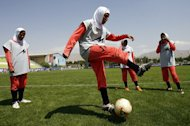 Players of Iran's women national football team warm up in 2009. Iran will lodge a formal complaint to the world football body after its women's team were barred from playing in an Olympic qualifier for wearing the traditional Islamic headscarf, media reports said Monday