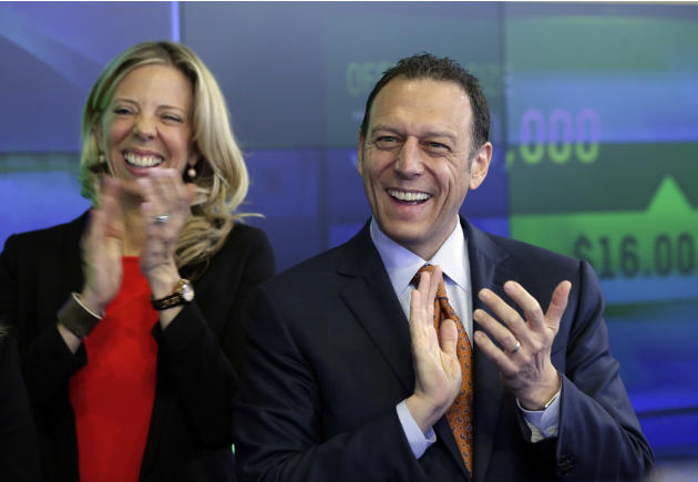 Sabre Corp. President & CEO Tom Klein, right, applauds after Sabre's IPO began trading, at the Nasdaq MarketSite, in New York, Thursday, April 17, 2014. Shares of Sabre Corp. rose over 3 percent i