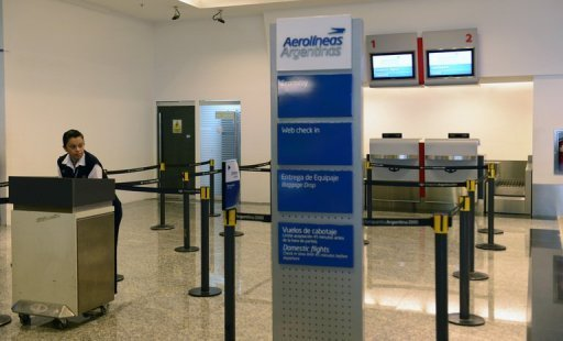A deserted check-in counter of Aerolineas Argentinas airlines at Aeroparque Jorge Newbery airport in Buenos Aires. Road and air transport delays gripped Argentina as President Cristina Kirchner, her approval rating in free fall, faced the second mass protest in as many weeks