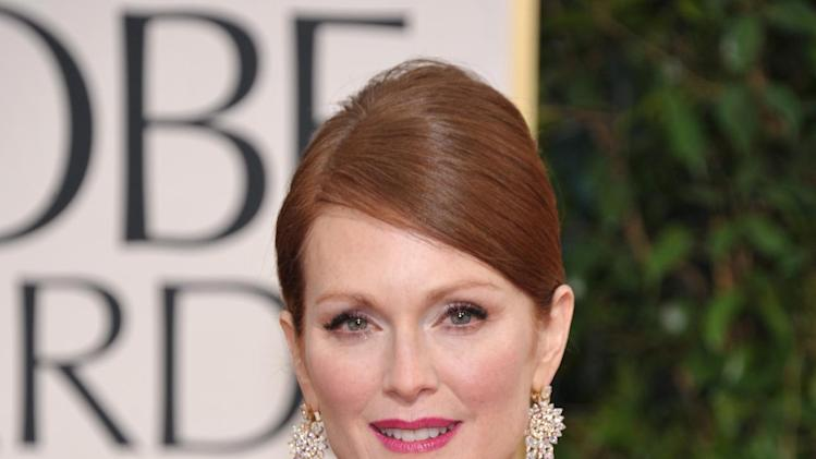 Actress Julianne Moore arrives at the 70th Annual Golden Globe Awards at the Beverly Hilton Hotel on Sunday Jan. 13, 2013, in Beverly Hills, Calif. (Photo by John Shearer/Invision/AP)