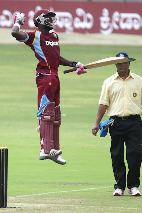 West Indies A player JL Carter celebrates his ton during the ODI match between India A and West Indies A at M Chinnaswamy Stadium, Bangalore on Sept. 17, 2013. (Photo: IANS)