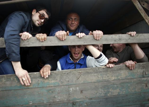 Pro-Russian protesters travel in a truck in Kramatorsk