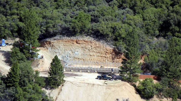In this undated photo released by Butte County Department of Public Works, marijuana grading violations are seen off of Lakeview Terrace in the Feather Falls area, with an unpermitted greenhouse under construction, in Butte County, Calif. With parts of Northern California's scenic hillsides illegally gouged by bulldozers for marijuana grows, frustrated local officials asked the state for help to protect tributaries of the Sacramento River from runoff of sediment and the chemicals used on plants. The Butte County supervisors hoped to charge growers with tougher penalties under federal and state clean water regulations than the grading infractions local officials could impose if the gardens were legal under state medical marijuana laws. (AP Photo/Butte County Department of Public Works)