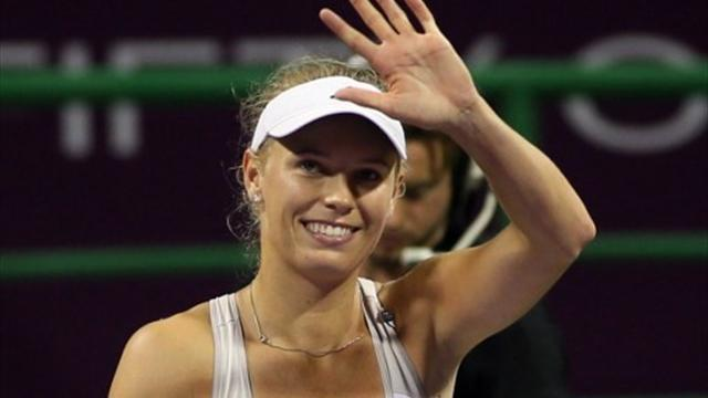 Tennis - Doha wins for Wozniacki and Ivanovic
