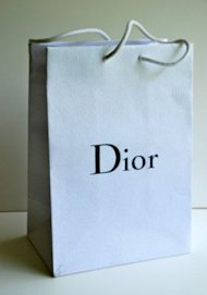 Some people are willing to pay for designer shopping bags. Photo via eBay.