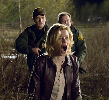 Nathan Fillion , Elizabeth Banks and Don Thompson (II) in Universal Pictures' Slither