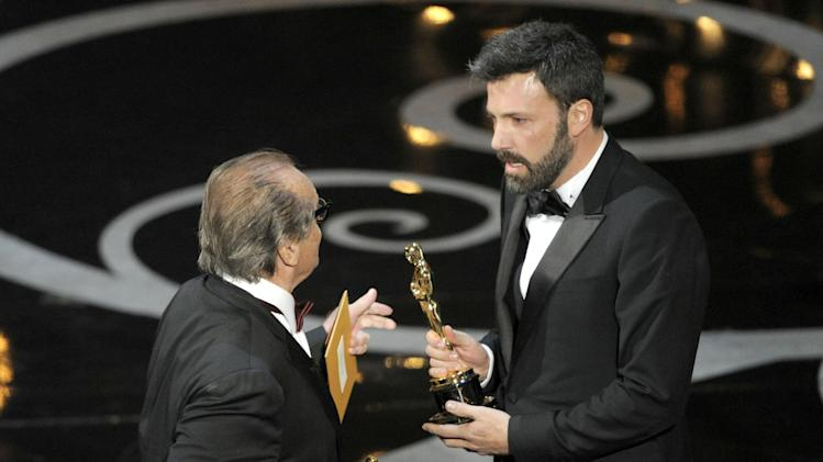 "Actor Jack Nicholson, left, presents the the award for best picture to producer/director Ben Affleck for ""Argo"" during the Oscars at the Dolby Theatre on Sunday Feb. 24, 2013, in Los Angeles.  (Photo by Chris Pizzello/Invision/AP)"