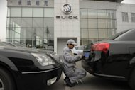 A mechanic works on a Buick at a General Motors dealership in Shanghai. Foreign carmakers in China say Beijing is pressuring them to produce dedicated new brands so their local partners can gain technical know-how, but experts warn the strategy could backfire